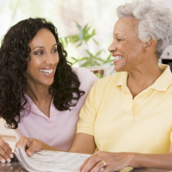caregiver assisting patient in reading