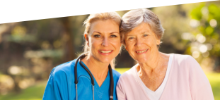 caregiver with stethoscope and patient smiling