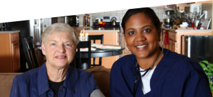 african american caregiver and patient smiling